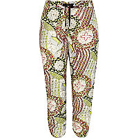 Green tribal print ruched hem crop trousers