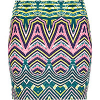 Green tribal print mini skirt