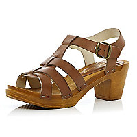 Light brown wooden clog sandals