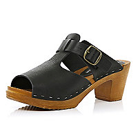 Black cut-out wooden clogs
