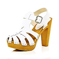 White gladiator clog heel sandals