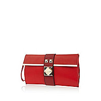 Red pyramid stud twist lock clutch bag
