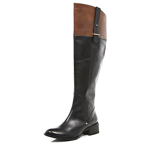 Black and tan riding boots
