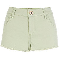Light green frayed denim shorts