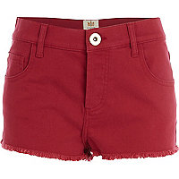 Red frayed denim shorts
