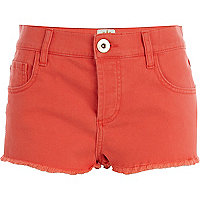 Orange frayed denim shorts