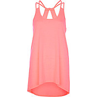 Bright pink cut out dip hem cami top