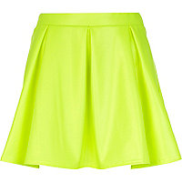 Bright yellow wet look skater skirt