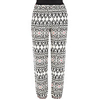 White tribal print trousers