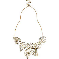 Gold tone filigree leaf statement necklace