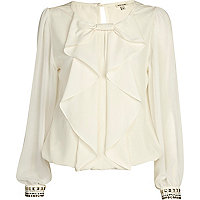 Cream frilly bow bubble hem top