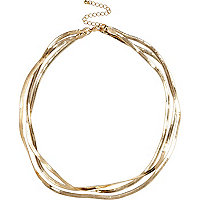 Gold tone slinky triple chain necklace