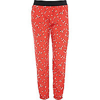 Red ditsy flower print cuffed hem trousers