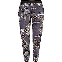 Purple tapestry print jogger trousers