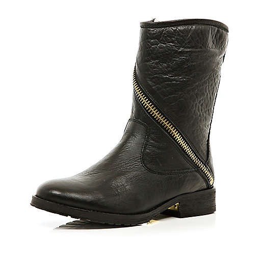 Black asymmetric zip boots