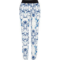 Blue symmetrical floral print trousers
