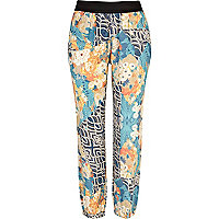 Blue tropical print trousers