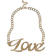 Gold tone oversized love necklace