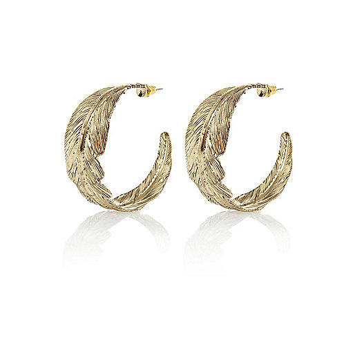 Gold tone leaf hoop earrings