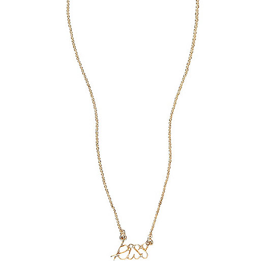 Gold tone kiss necklace