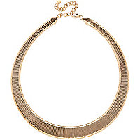 Gold tone slinky statement necklace
