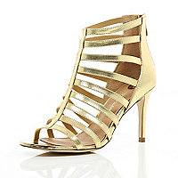 Gold mid heel gladiator sandals