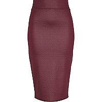 Dark red coated textured tube skirt