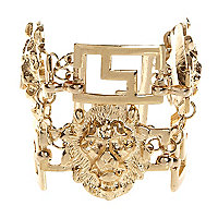 Gold tone lion gate bracelet