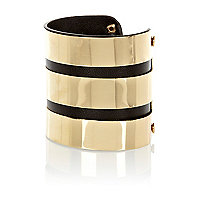 Black leather look and gold tone metal cuff