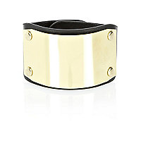 Black and gold tone plate bracelet