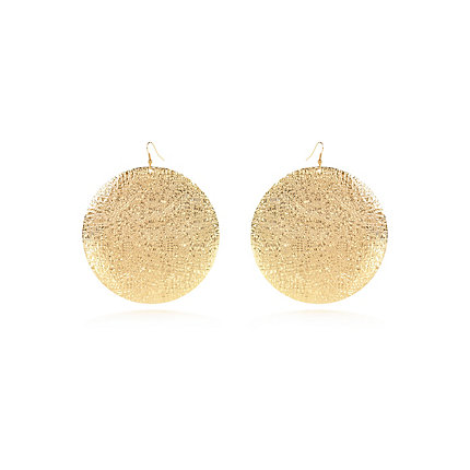Gold tone textured oversized disc earrings