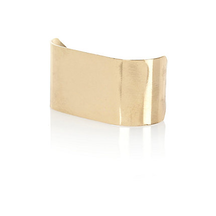 Gold tone multi finger plate ring