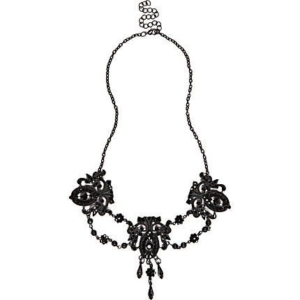 Black chandelier repeat statement necklace