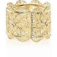 Gold tone filigree stretch cuff bracelet