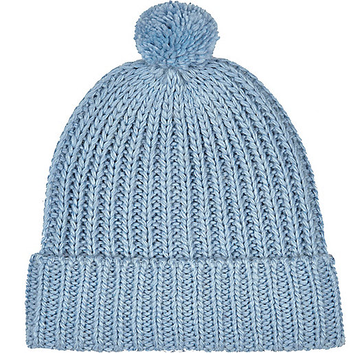 Light blue pom pom beanie hat