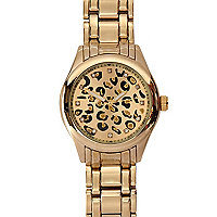 Gold tone leopard print round watch