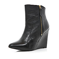 Black pointed wedge boots