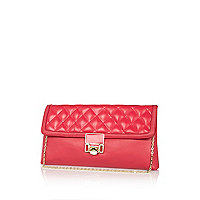 Pink quilted panel clutch bag