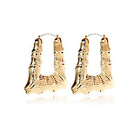 Gold tone triangle creole earrings