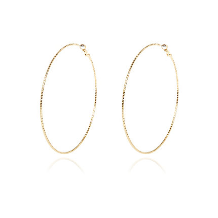 Gold tone oversized twist hoop earrings