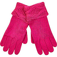 Bright pink cable knit cuff gloves