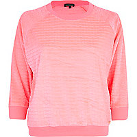 Bright pink textured velour sweat top