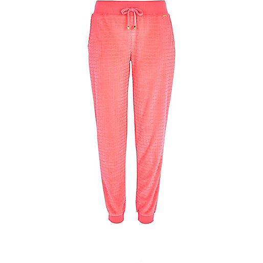 Bright pink textured velour joggers