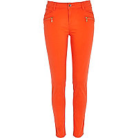 Bright red skinny biker trousers