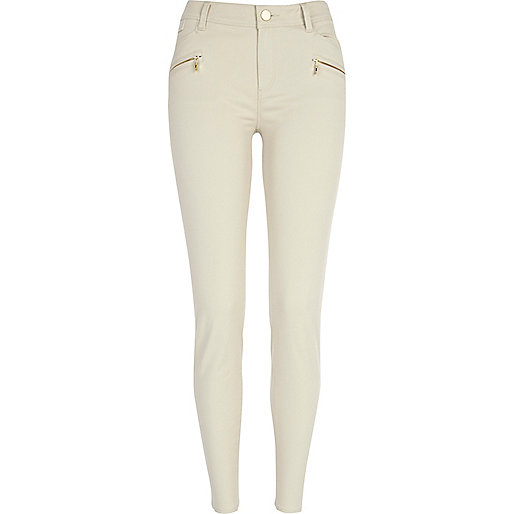 Light beige skinny biker trousers