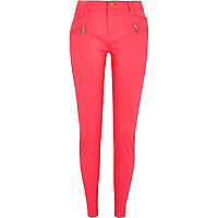 Bright pink skinny biker trousers