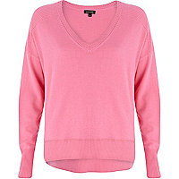 Bright pink elbow patch oversized jumper