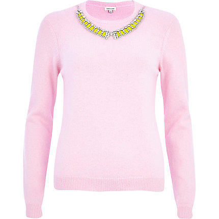 pink jumper with necklace