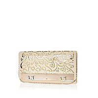 Cream laser cut metal plate trim clutch bag