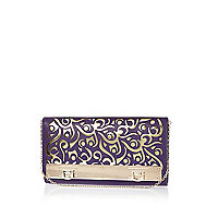 Purple laser cut metal plate trim clutch bag